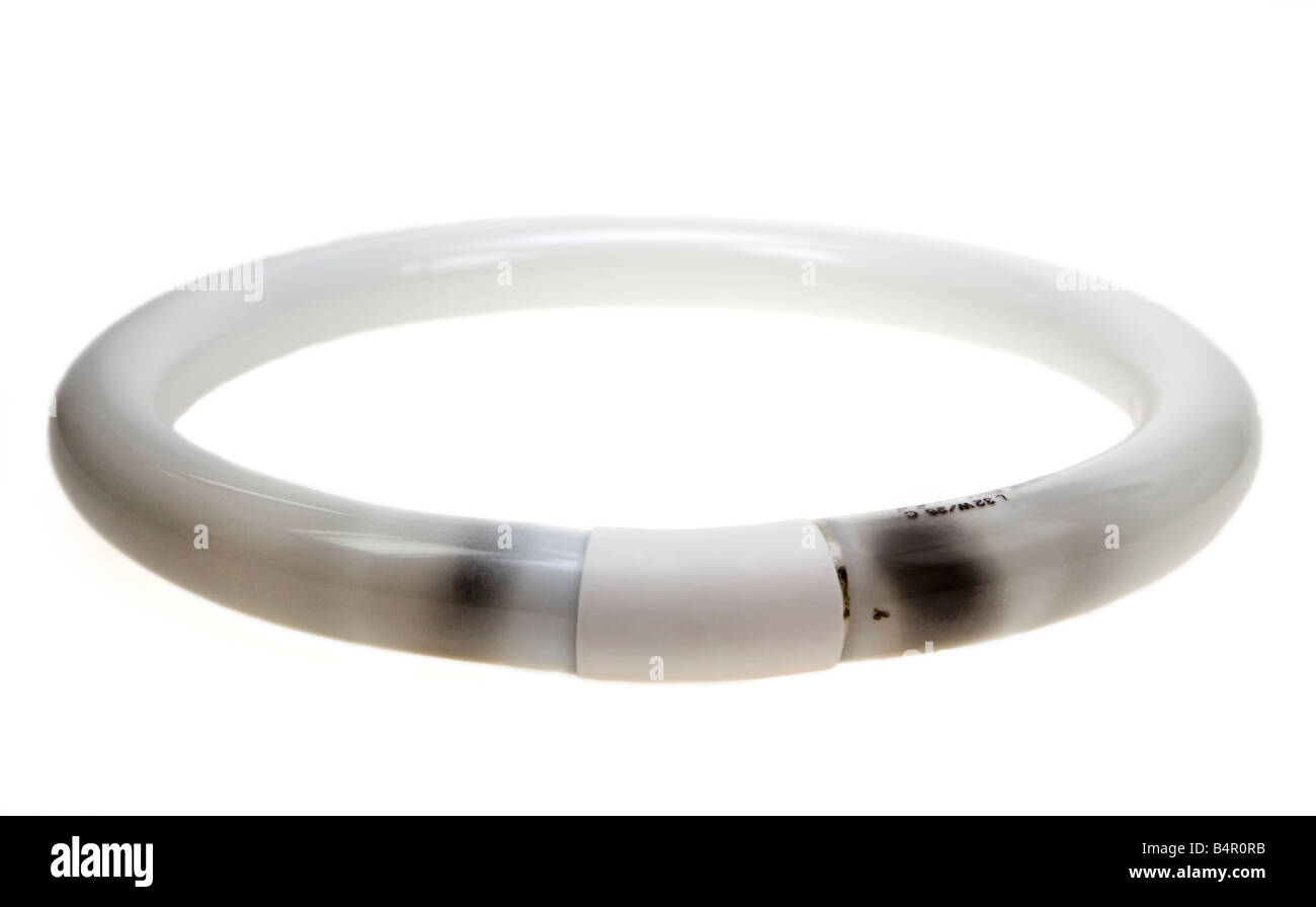 Burned out circular fluorescent tube - Stock Image