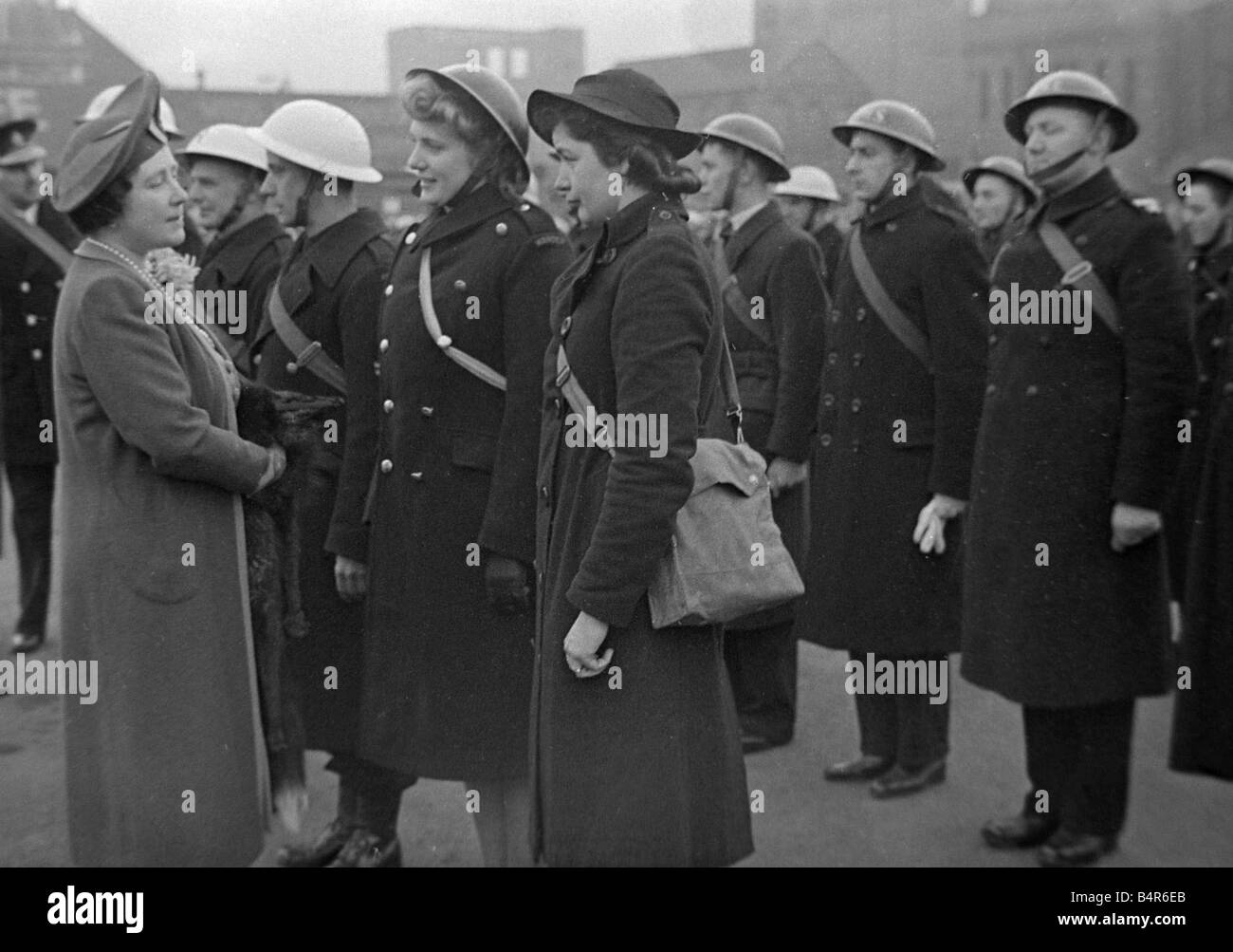 The Queen seen here meeting some of the Rescue Services which where on duty in Coventry during the heavy air raid - Stock Image