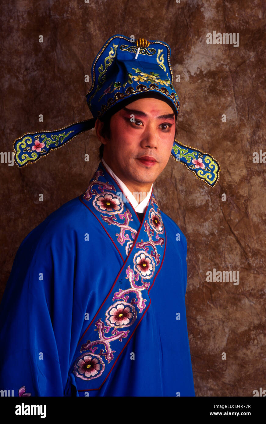 chinese opera man performer traditional clothing stage make up - Stock Image