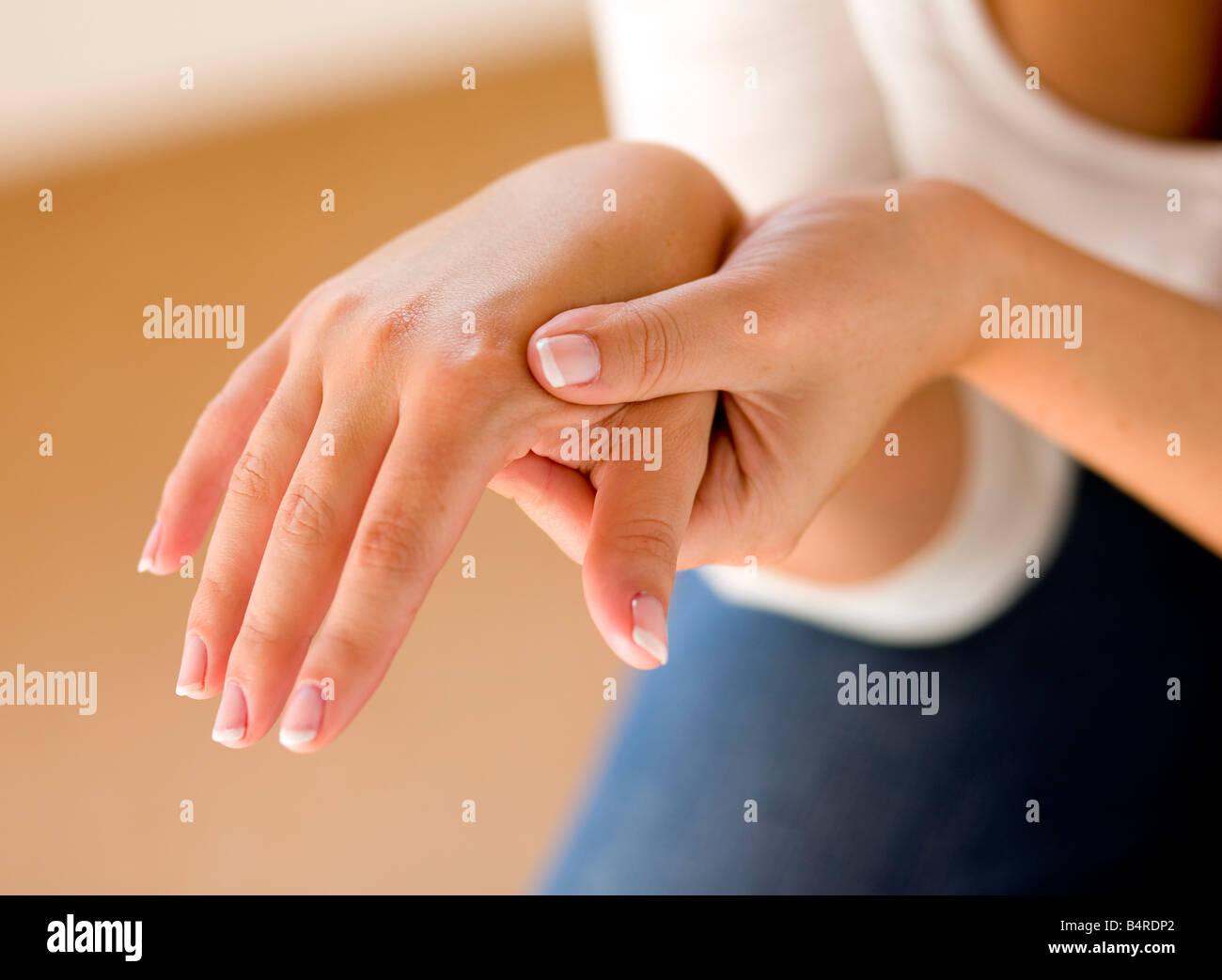 Woman massaging hands - Stock Image