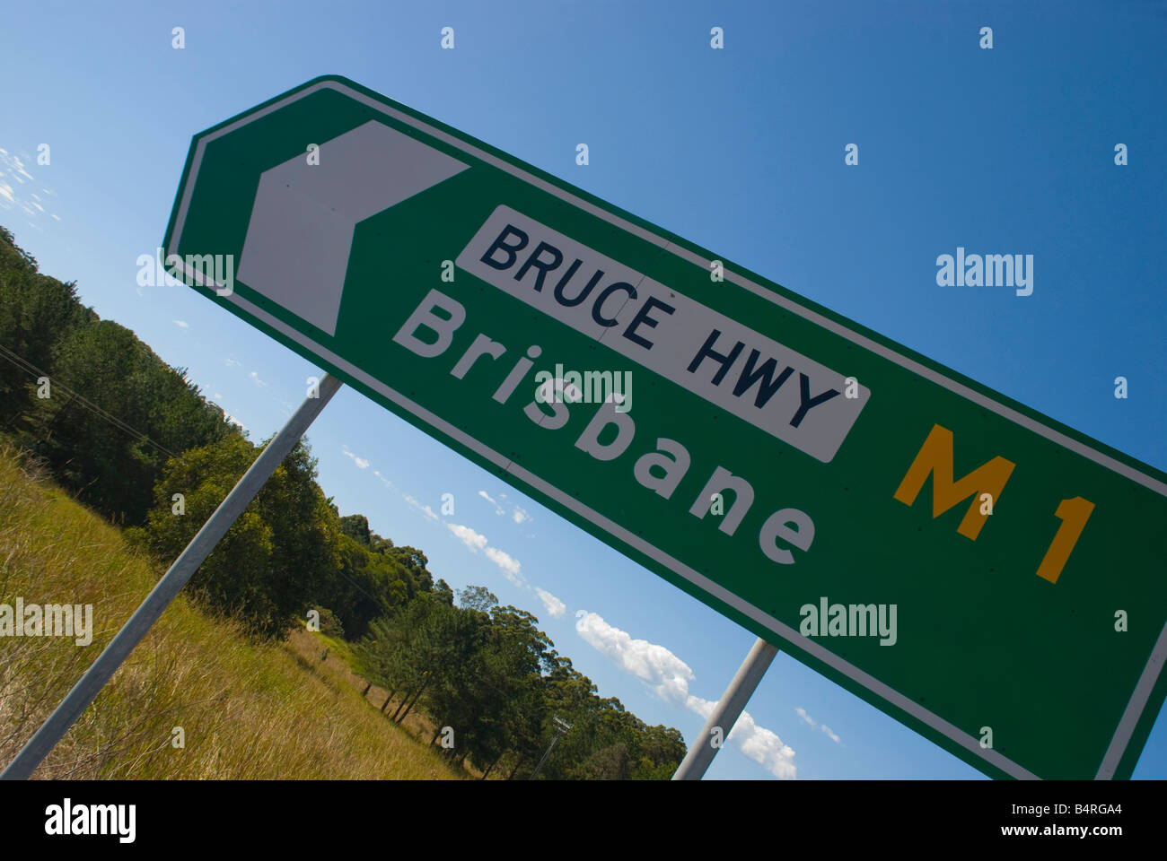 Highway sign pointing to the city of Brisbane on the Bruce Highway in Queensland - Stock Image