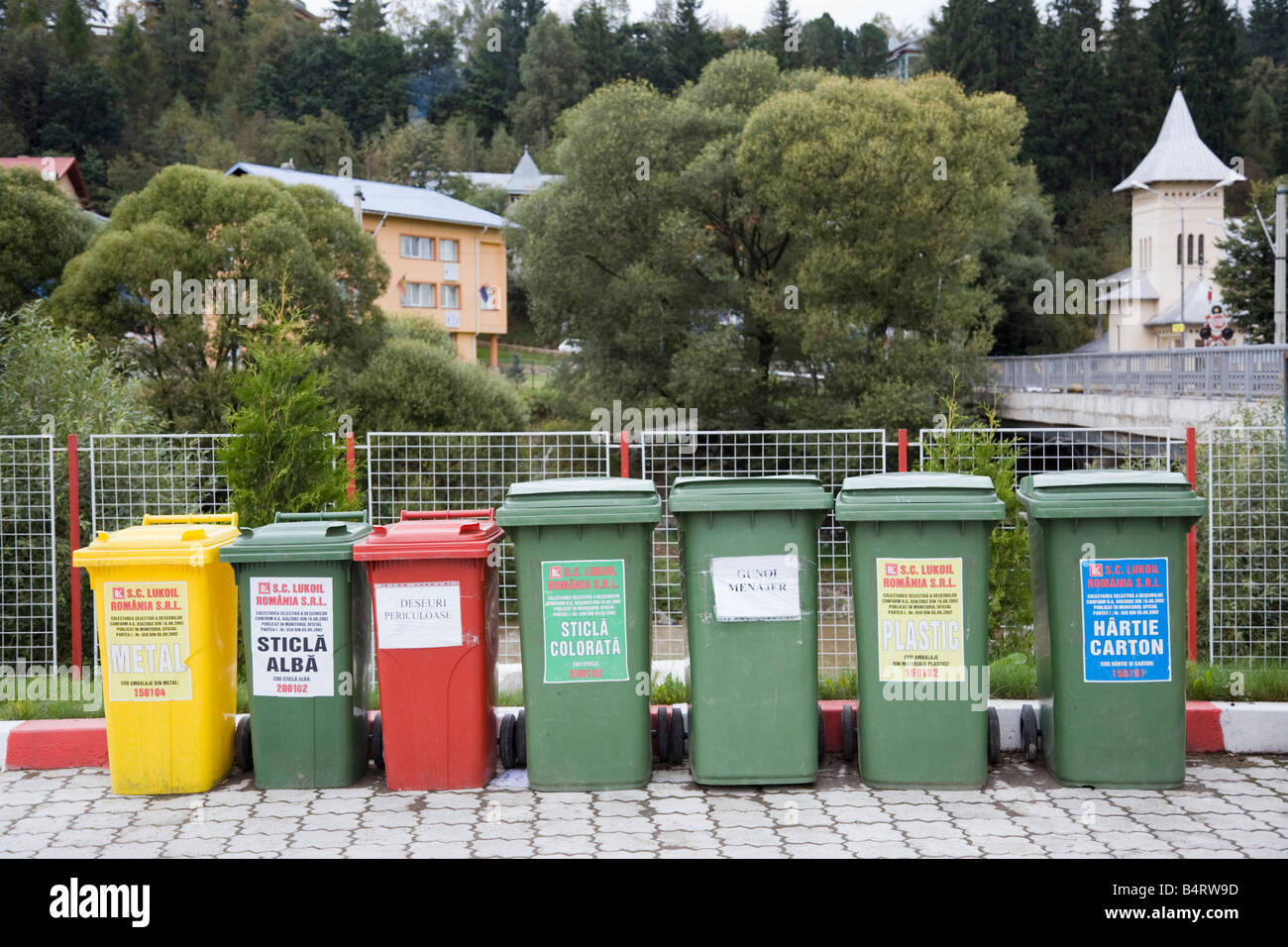 Romania Europe Line of coloured Wheelie bins for recycling Stock Photo