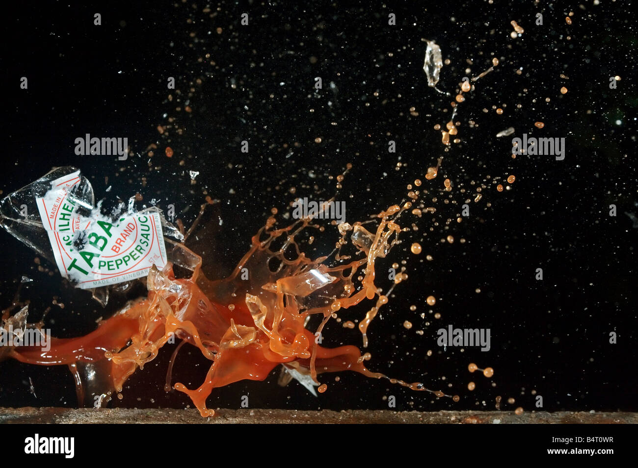 Bottle of Tabasco sauce gets smashed - Stock Image