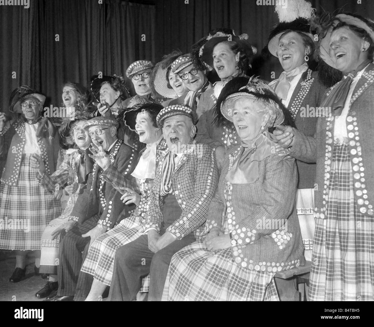 Pearly kings and queens singing during a concert - Stock Image