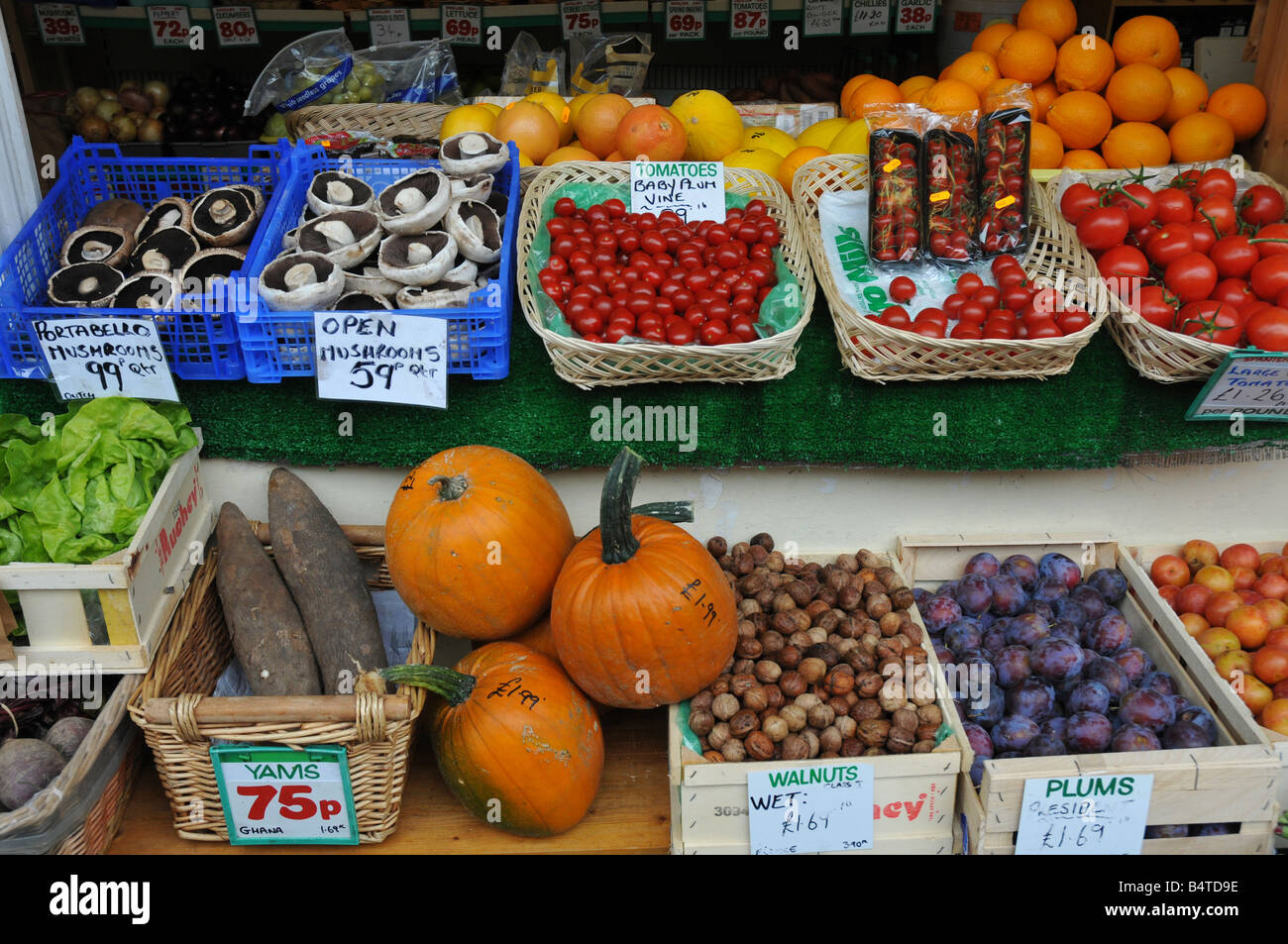 Fresh local grown fruit and vegetables on sale at the Barnstaple Pannier market in North Devon England. - Stock Image