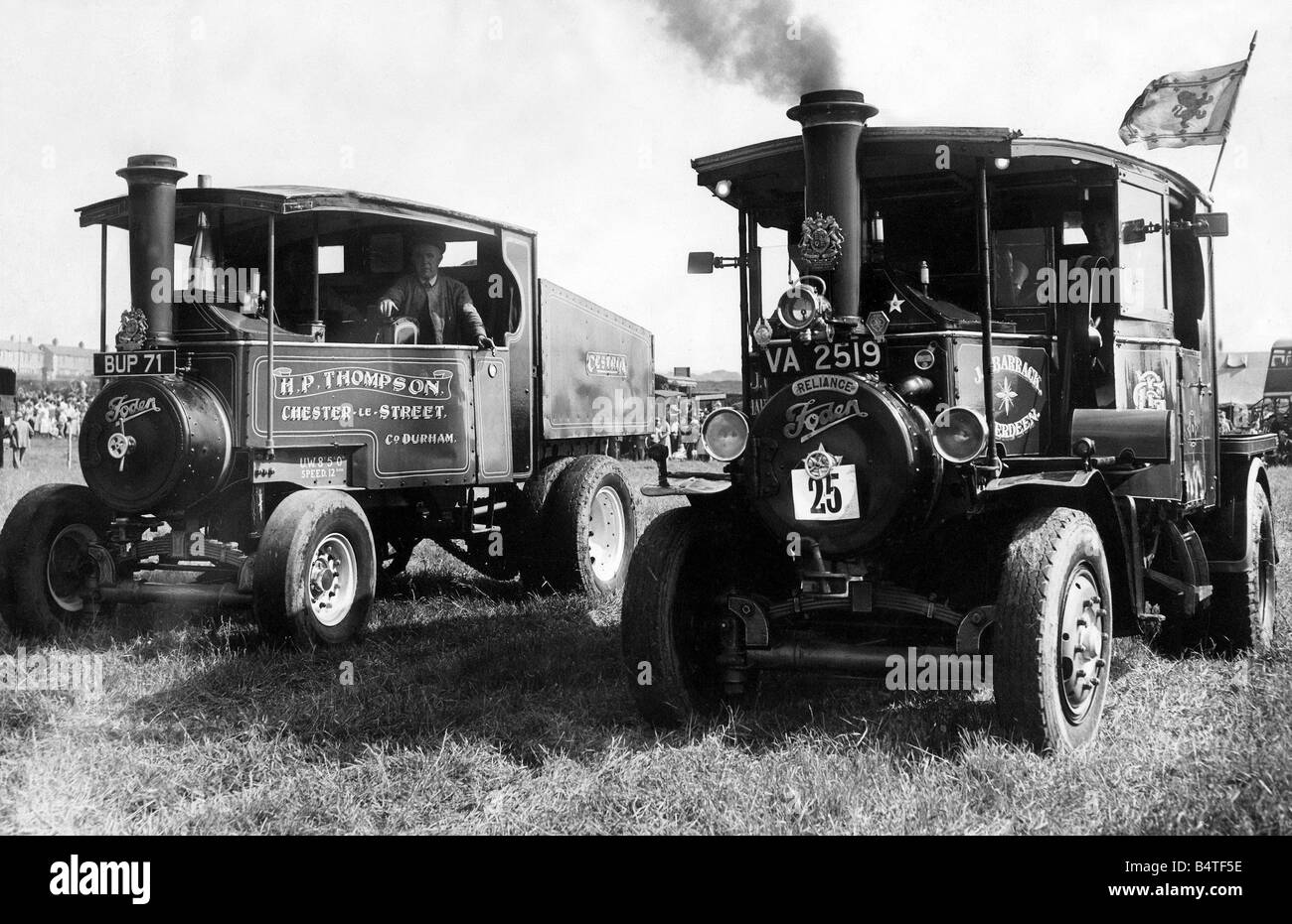 Tractors race at a rally as they are no longer used on a farm - Stock Image