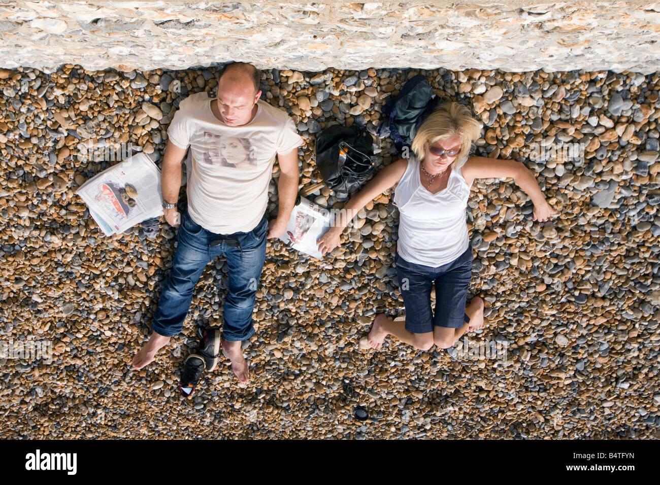 sunbathers on brighton beach, england - Stock Image