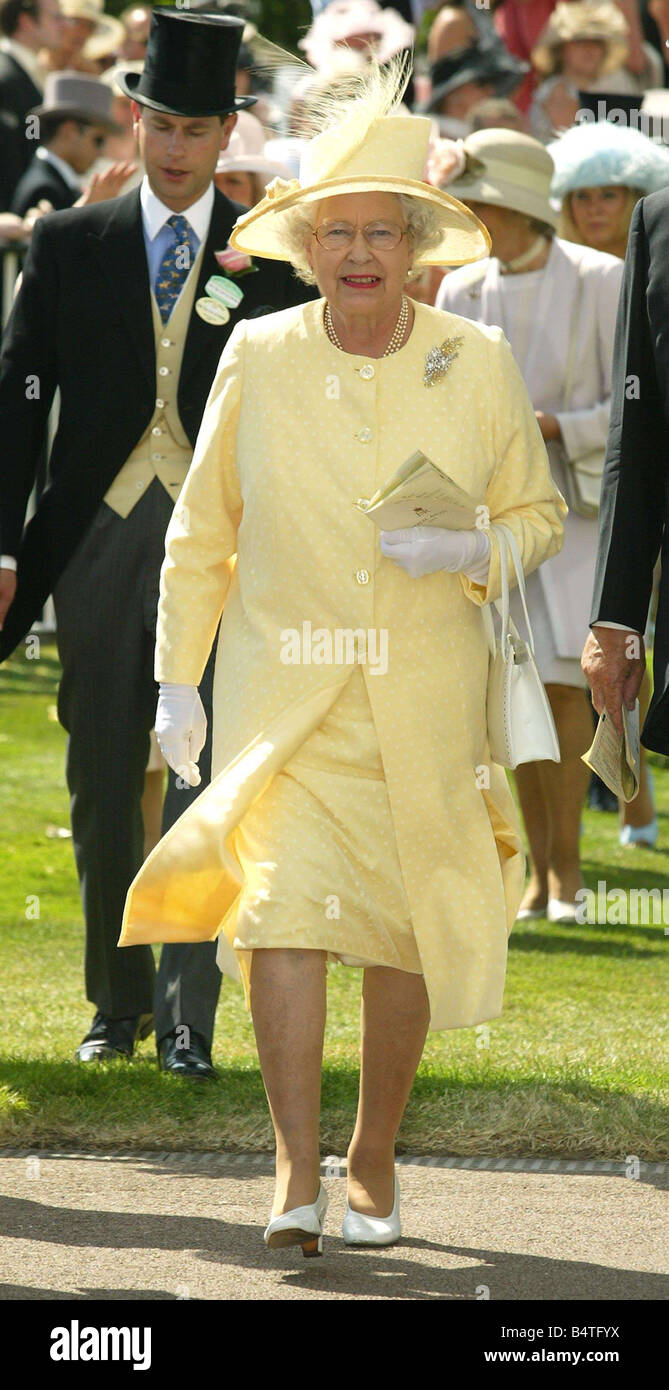 Queen Elizabeth II with the Count and Countess of Wessex among race goers  at Royal Ascot yellow hat yellow costume horse racing cf7365527e6