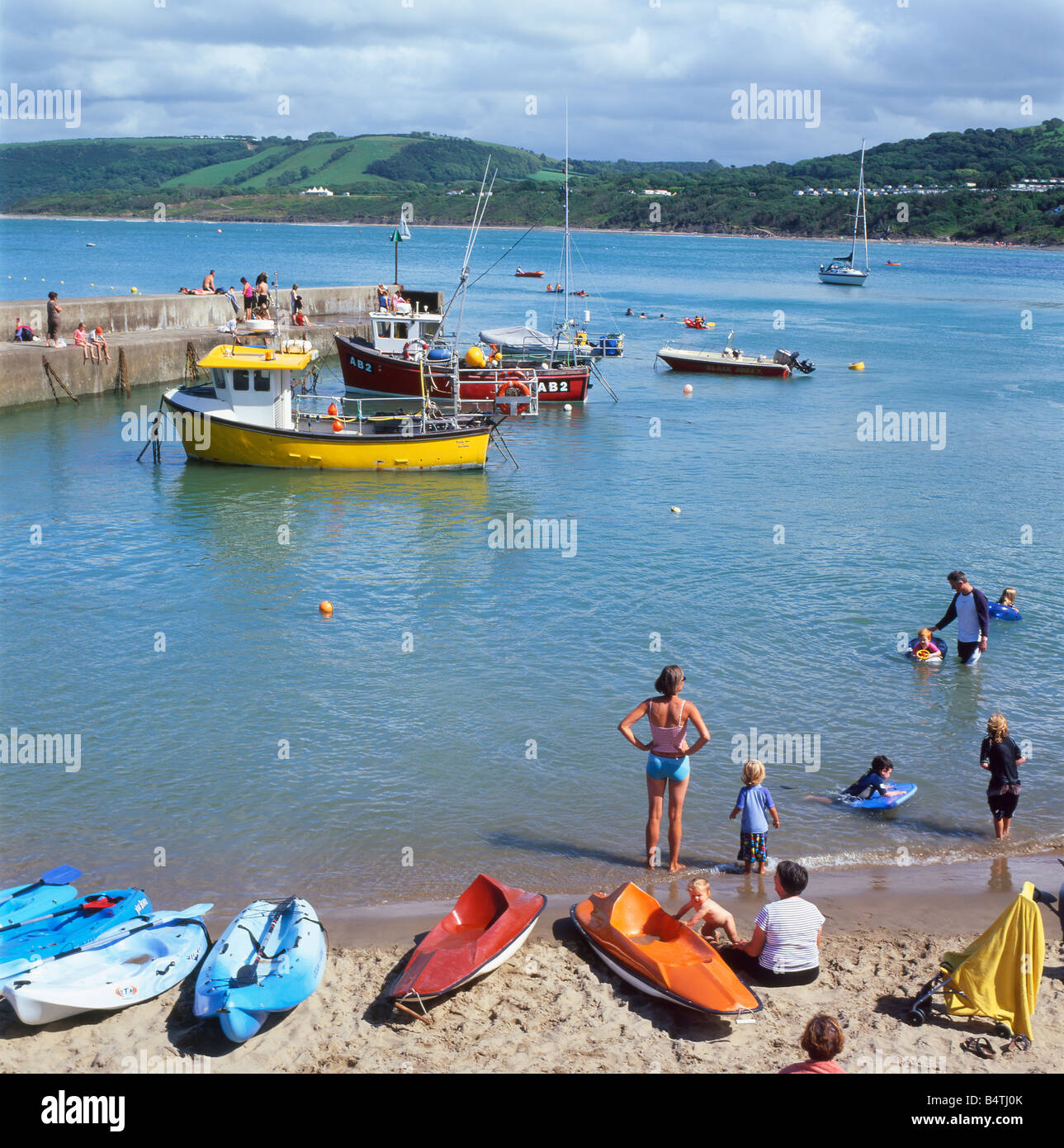 People and boats in New Quay Harbour, Ceredigion West Wales UK  KATHY DEWITT - Stock Image