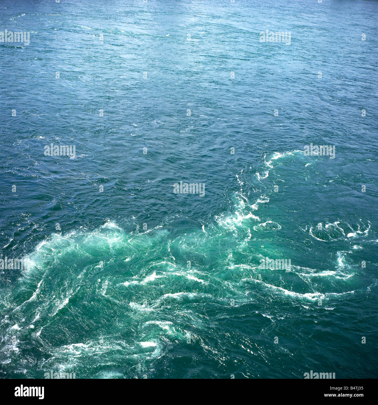 The swirling waters of the swift flowing Niagara River viewed from the Peace Bridge, Ontario Canada KATHY DEWITT - Stock Image