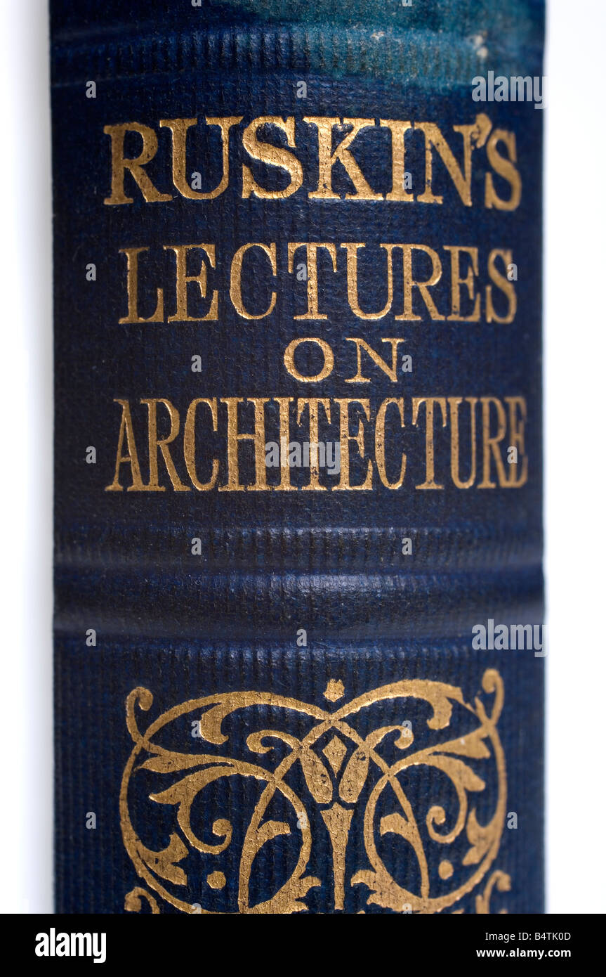 The name of the author, Ruskin, engraved in gold on the binding of an old book of his works - Stock Image