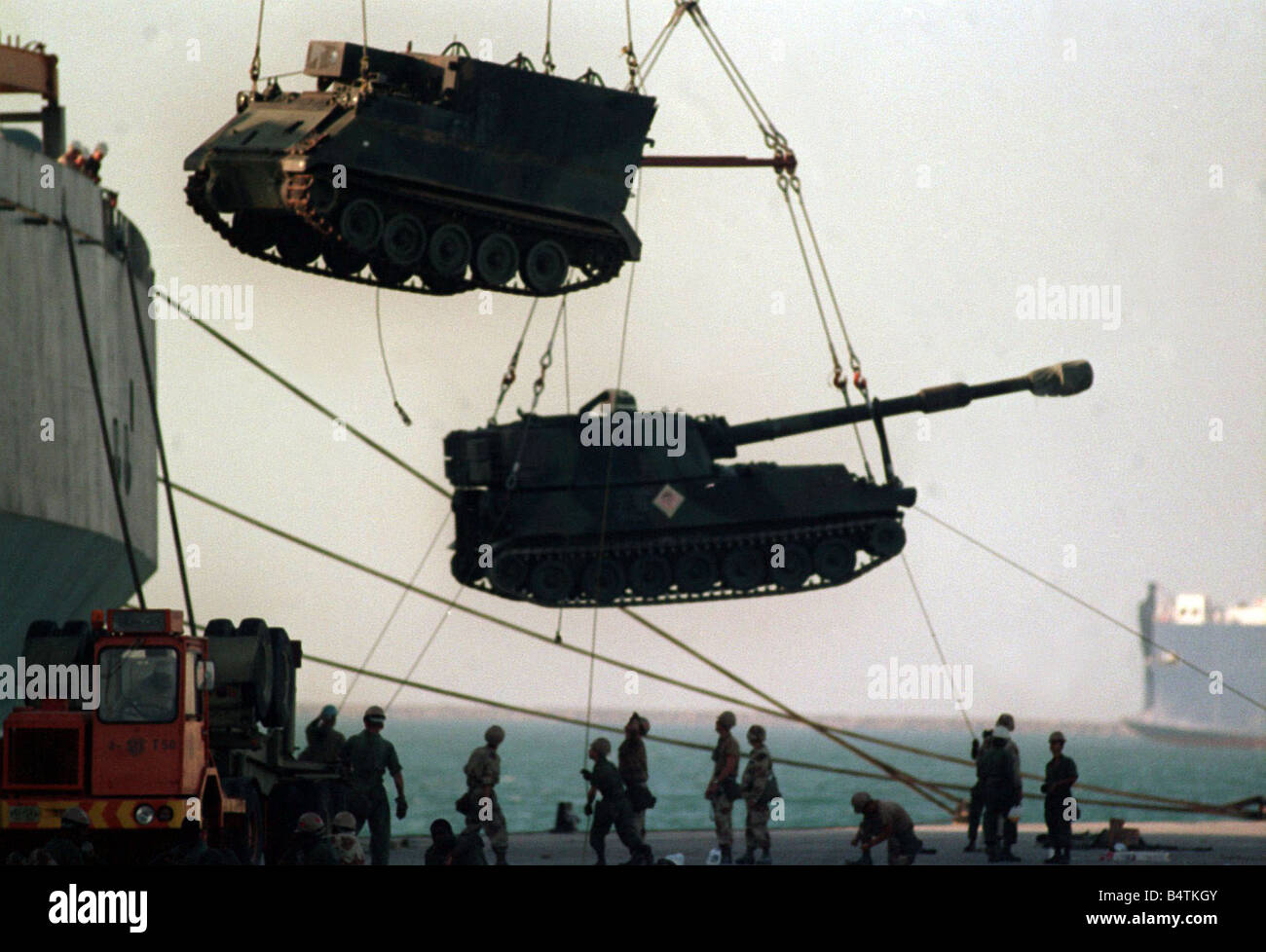 Gulf War Operation Desert Storm Tanks and mobile guns are unloaded from transport ships October 1990 - Stock Image