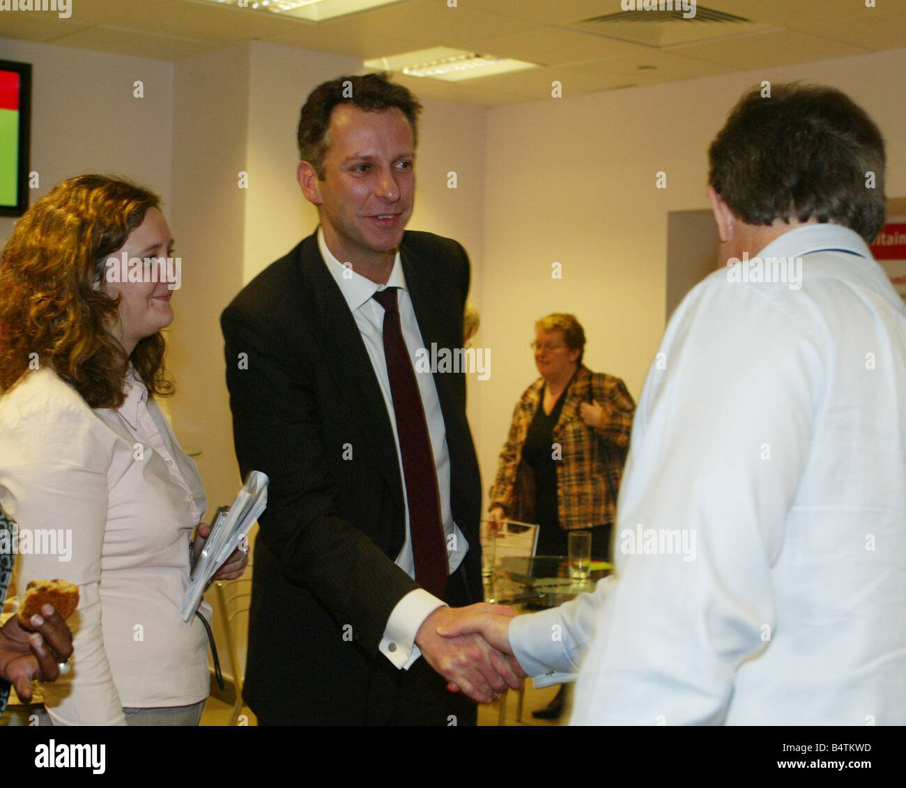 Prime Minister Tony Blair 21st April 2005 With the Mirror s Readers Poll Group at Labour Party election Headquarters - Stock Image