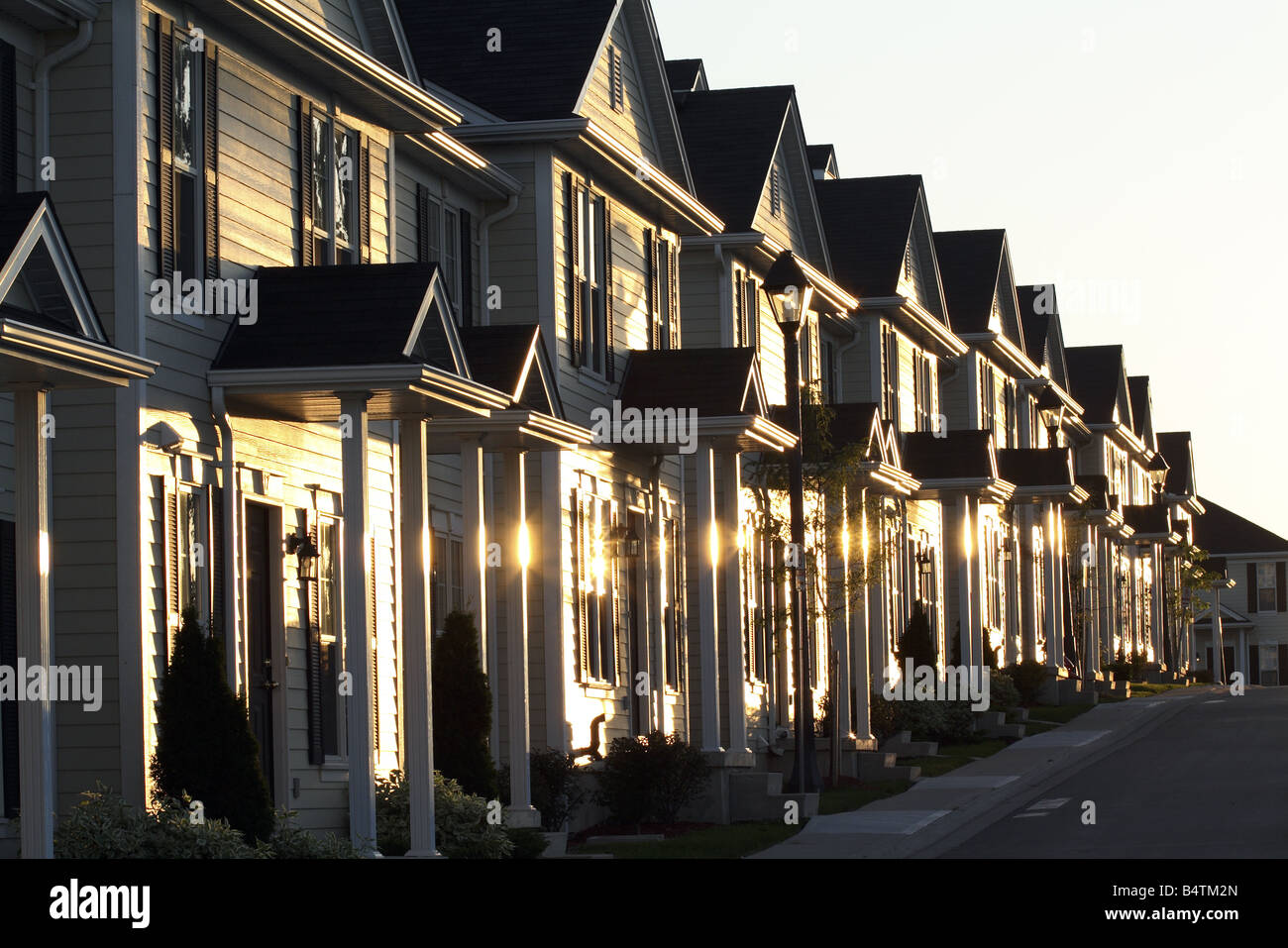 Townhouses in a Row Gleaming at Sunset London Ontario Canada - Stock Image