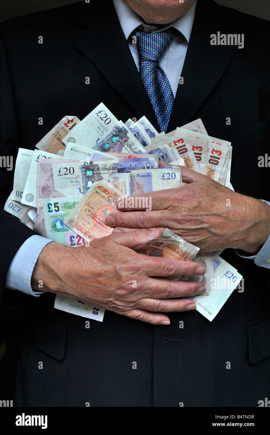 man wearing office business suit hands clutching piles of money