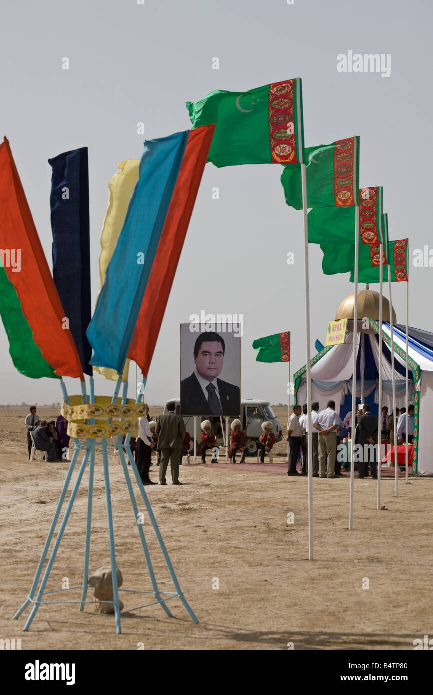 Flags and tented pavilion for reception for delegates of international conference at Ulug Depe archaeological site, Stock Photo