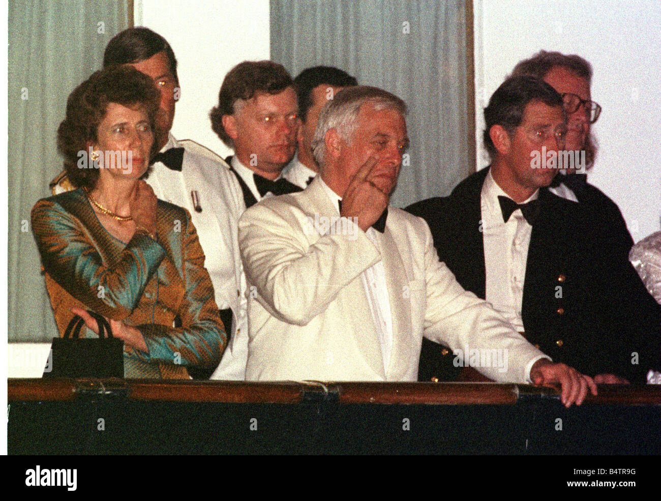 Chris Patten Governor of Hong Kong for Handover June 1997 watches the Beating the Retreat on the Royal Yacht Britania - Stock Image