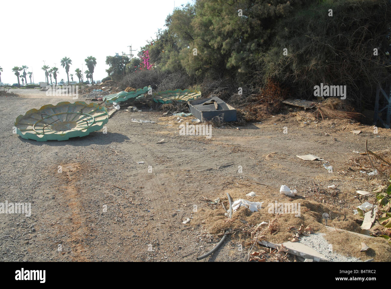 Building material and other trash discarded in the countryside - Stock Image