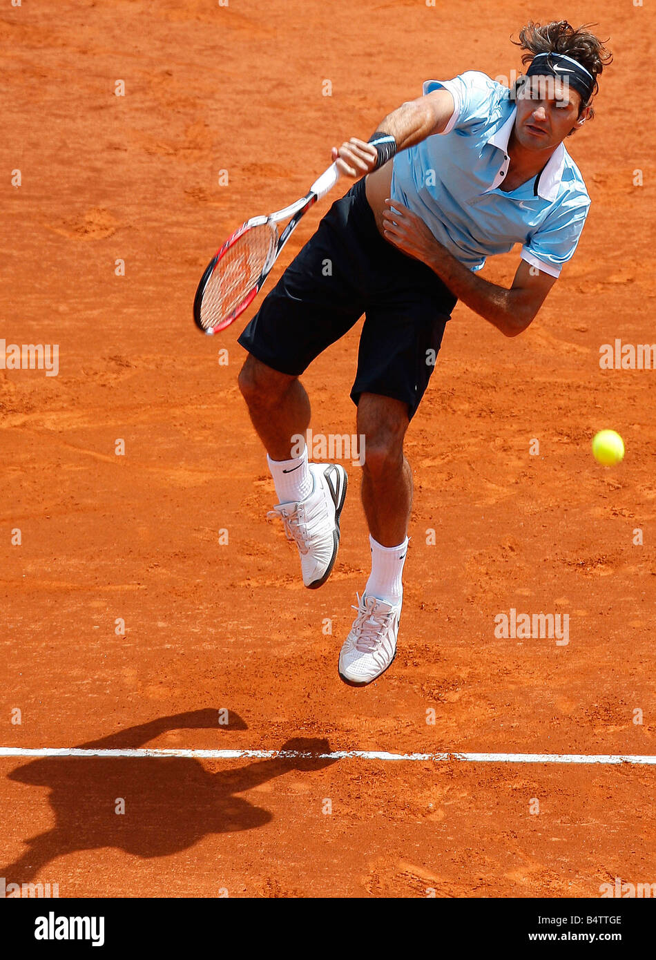 Roger Federer in action against Rafeal Nadel in the Final of the ATP Masters in Monaco 2008. - Stock Image