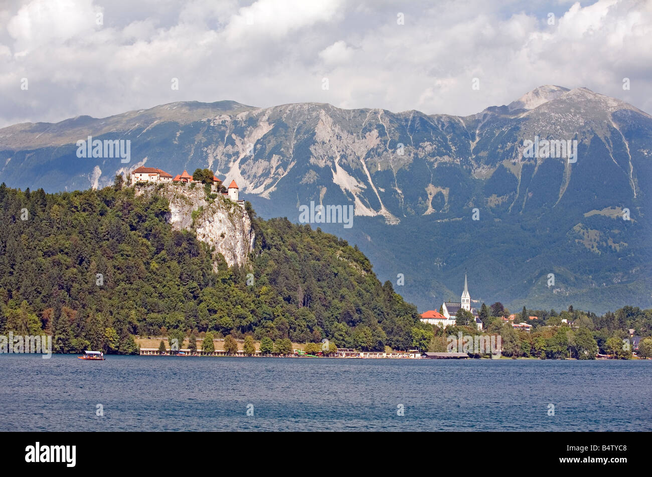 Lake Bled Republic of Slovenia Medieval castle Bled on the rock and mountain Stol in the background - Stock Image