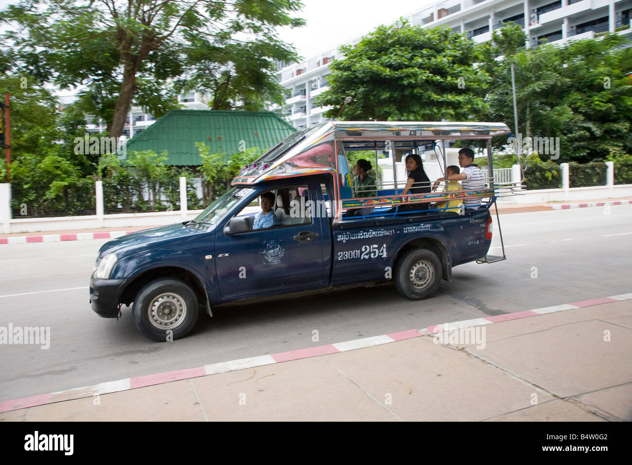 "Traditional ""Tuktuk"" taxis, Shared Mobile open-air, passenger vehicle, Baht Bus, Songthaew, Tuk-Tuk, or Taxi,  Advertising - Stock Image"