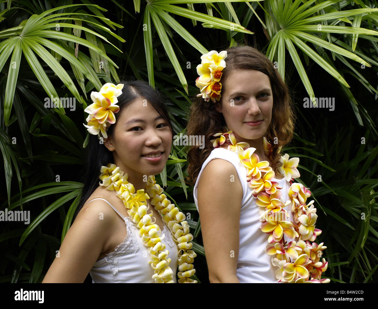 Two girls with leis - Stock Image