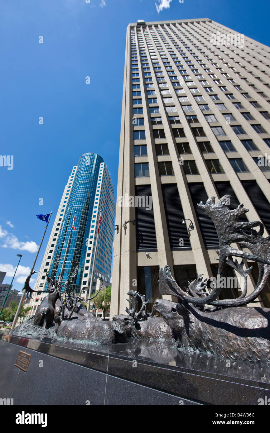 Bronze sculpture of caribous crossing river, outside the Richardson Building with the Canwest Place building Stock Photo