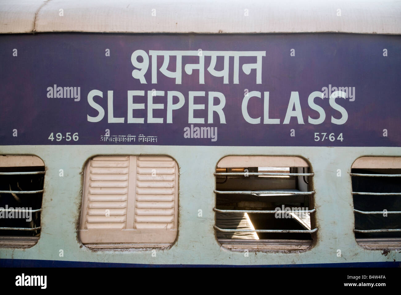 A sleeper class rail passenger coach on a train, New Delhi railway station, India Asia - Stock Image