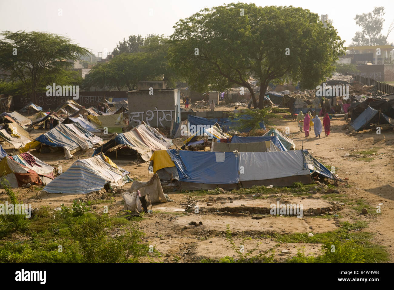 People living in slums - a tented village in the slums of New Delhi, India, Asia - Stock Image