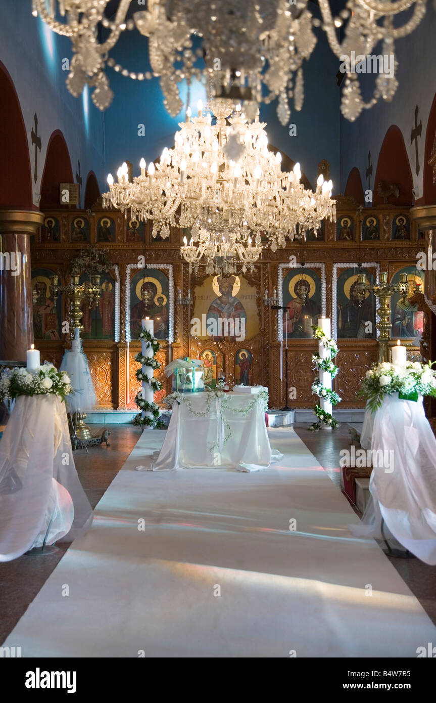 Wedding altar prepared for christian orthodox wedding ceremony stock wedding altar prepared for christian orthodox wedding ceremony inside church greece europe flower decoration white carpet junglespirit Image collections