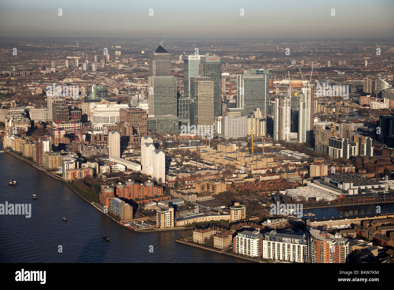 Aerial view north east of Canary Wharf tower blocks Millwall Outer Dock residential buildings River Thames London - Stock Image