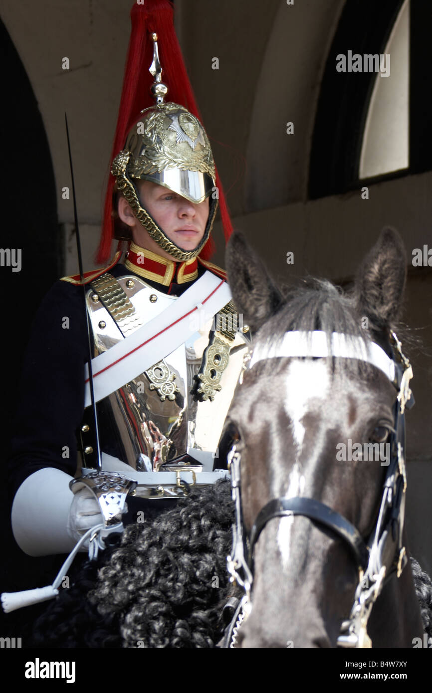 Soldier of the Household Cavalry from the Blues and Royals regiment mounted in Whitehall CIty of Westminster SW1 Stock Photo