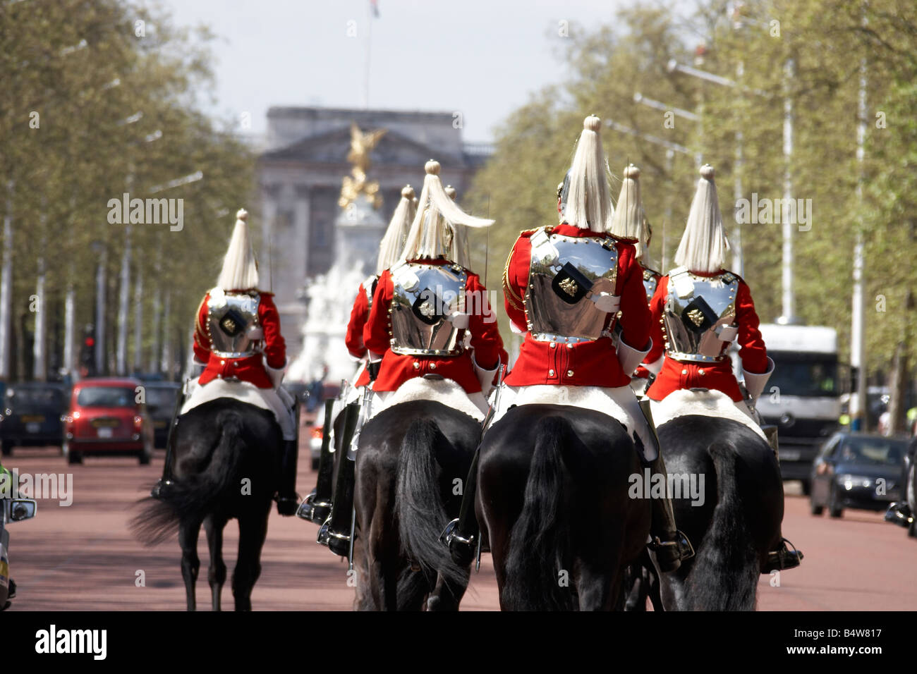 Group of mounted soldiers of the Household Cavalry from The Life Guards regiment on The Mall CIty of Westminster Stock Photo