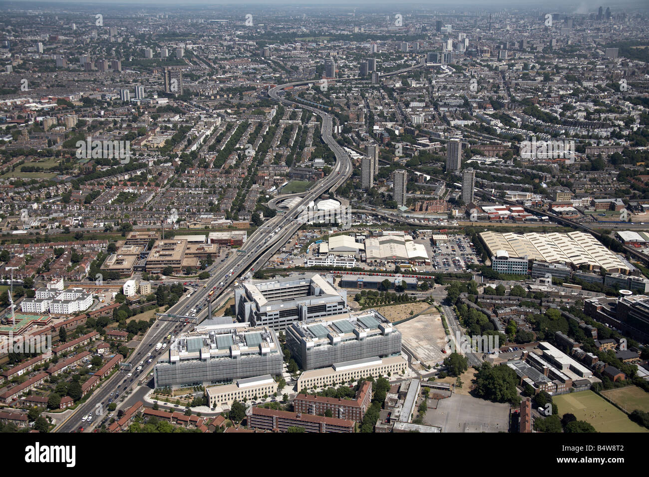 Aerial view north east of Westway A40 BBC offices White City suburban housing tower blocks London W10 W11 W12 UK - Stock Image