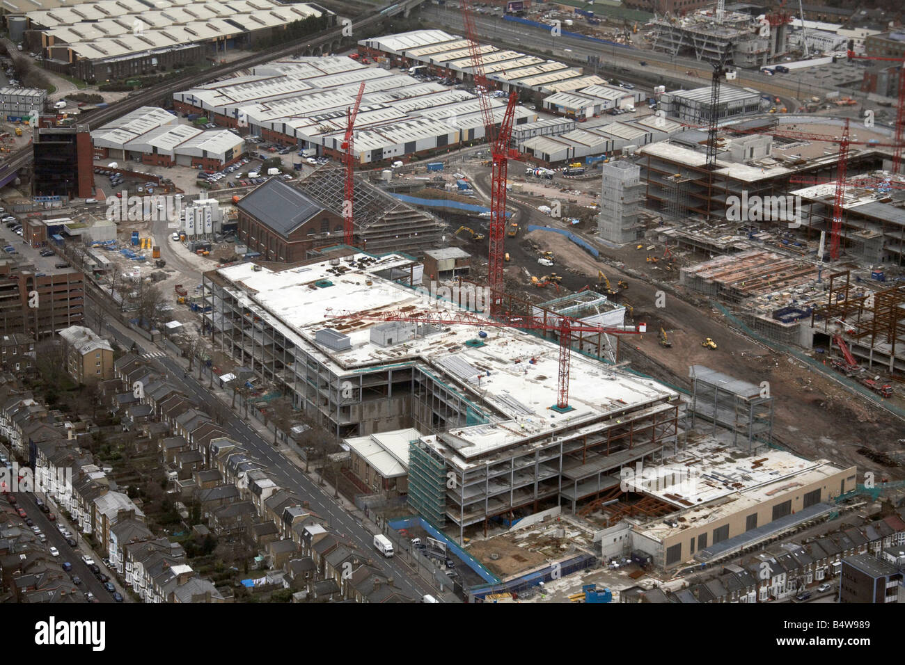 Aerial view north east of Westfield White City Development Construction Site suburban houses Wood Lane London W12 Stock Photo