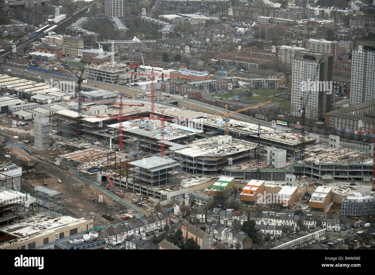 Aerial view north east of Westfield White City Development Construction Site suburban houses tower blocks London Stock Photo