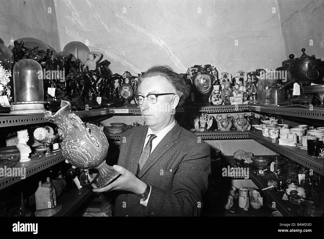 Bowes Museum Jan 1970 Director Frank Atkinson studies some of the antque items donated towards the open air museum - Stock Image