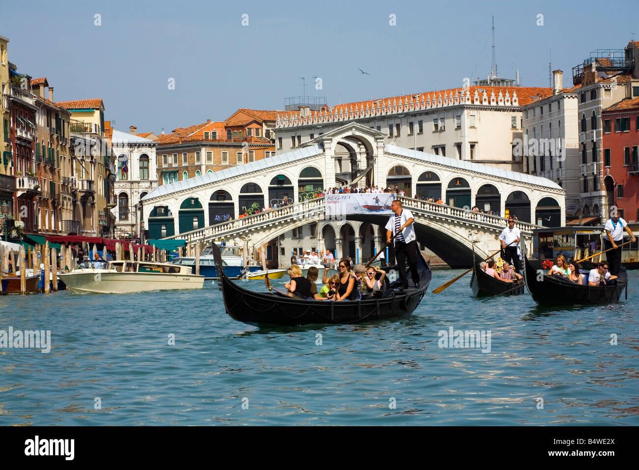 Taking a Gondola ride near the Rialto Bridge in Venice Italy. ( Add keyword TRAVELSHOTS  to search box to see 50 - Stock Image
