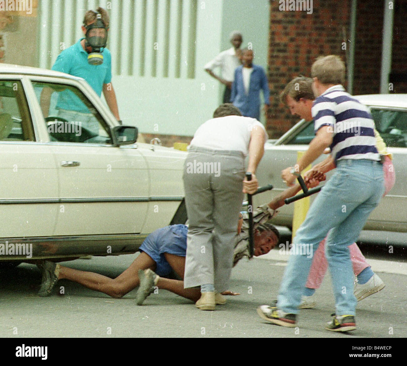 A South African boy is beaten by police in Kimberley South Africa during the rebel cricket tour in South Africa - Stock Image