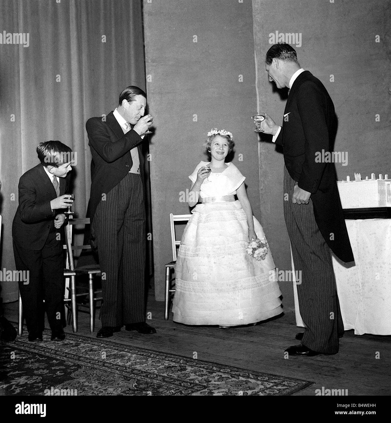 A young Prince Charles January 1960 joins in a toast for his elder sister Princess Anne with his father the Duke - Stock Image
