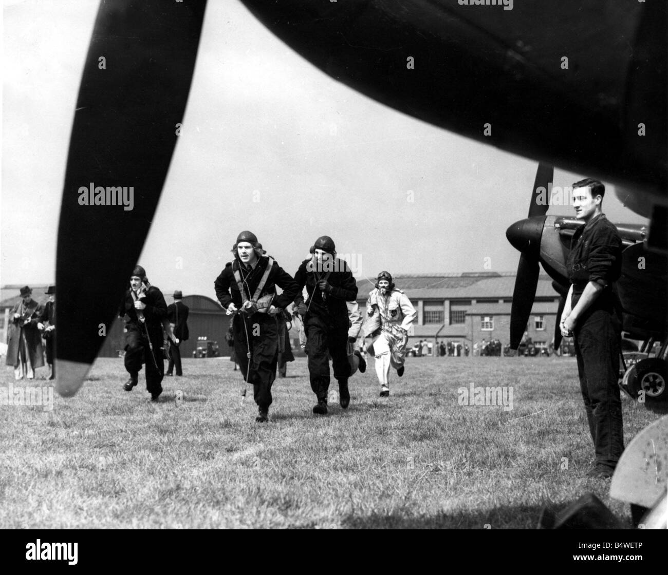 War World War II Battle of Britain Picture shows Spitfire pilots rushing to their fighter planes as they scramble - Stock Image