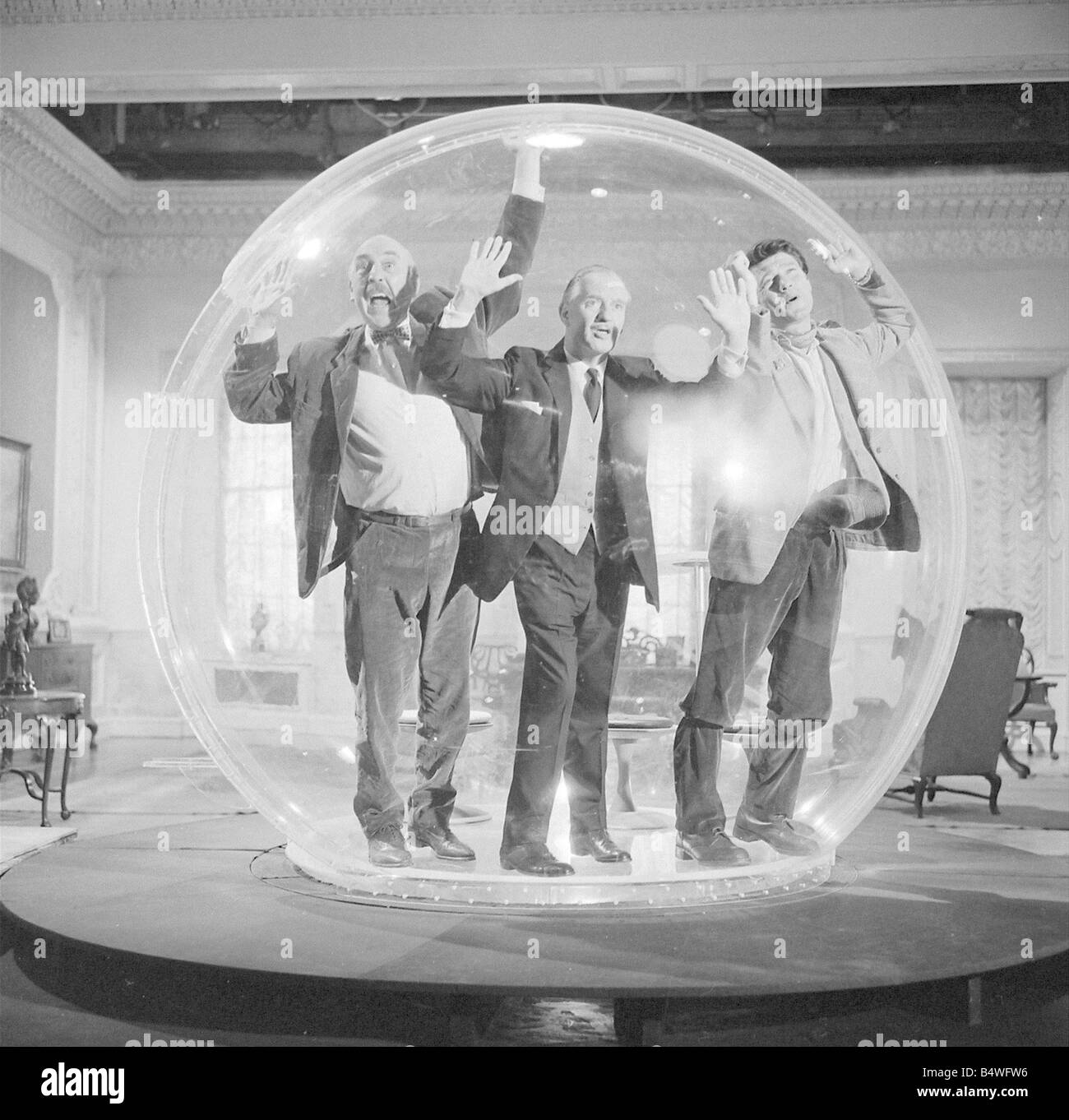 Left to right Lionel Jeffries Eric Portman and Laurence Harvey seen here on the set of The spy with a cold nose - Stock Image