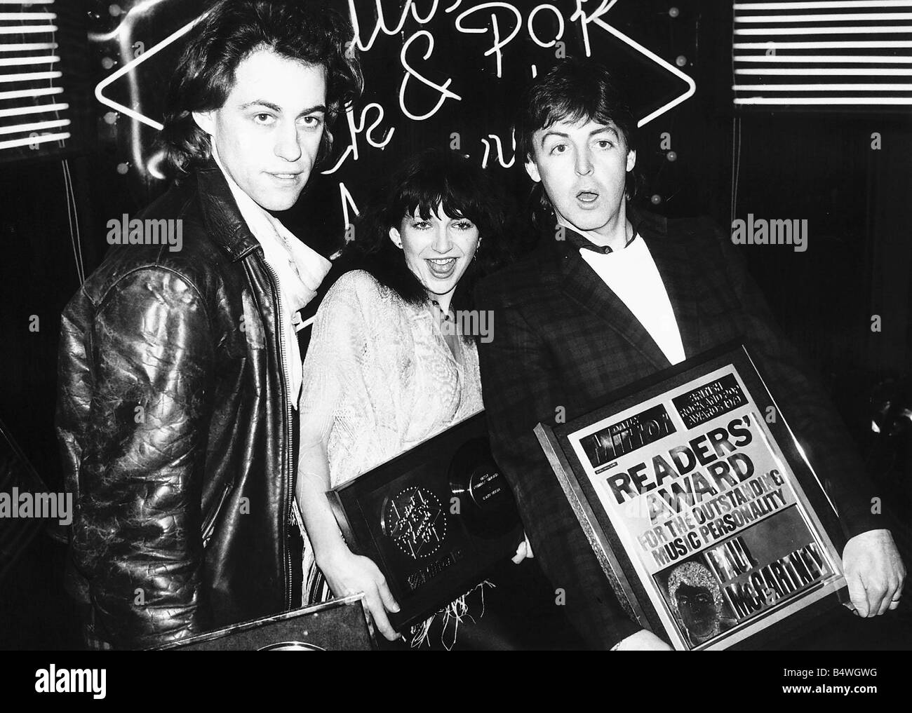 Kate Bush with fellow pop singers Bob Geldof and Paul McCartney at The British Rock and Pop Awards February 1980 Stock Photo
