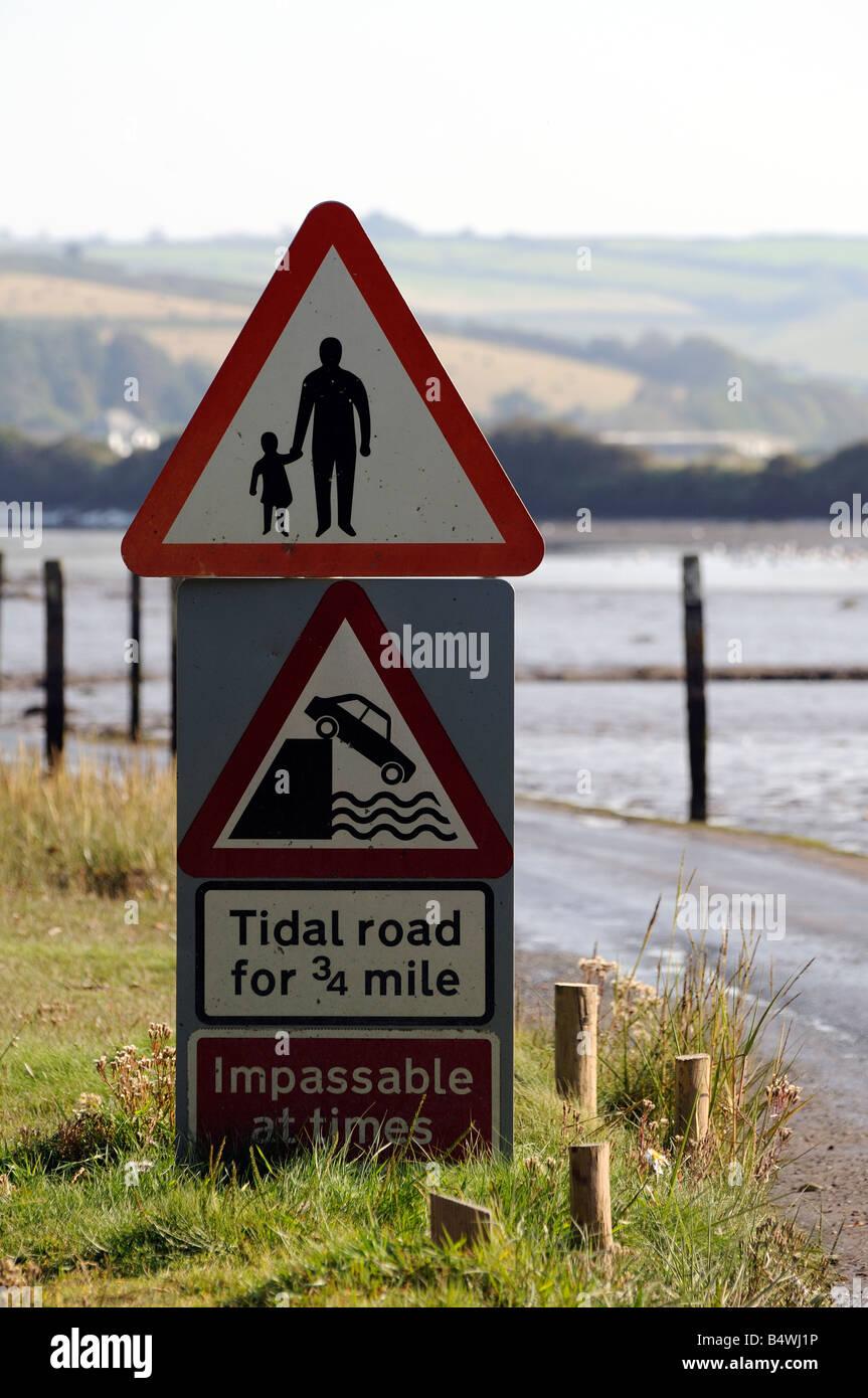 Tidal road signs on River Avon at Aveton Gifford Devon England - Stock Image