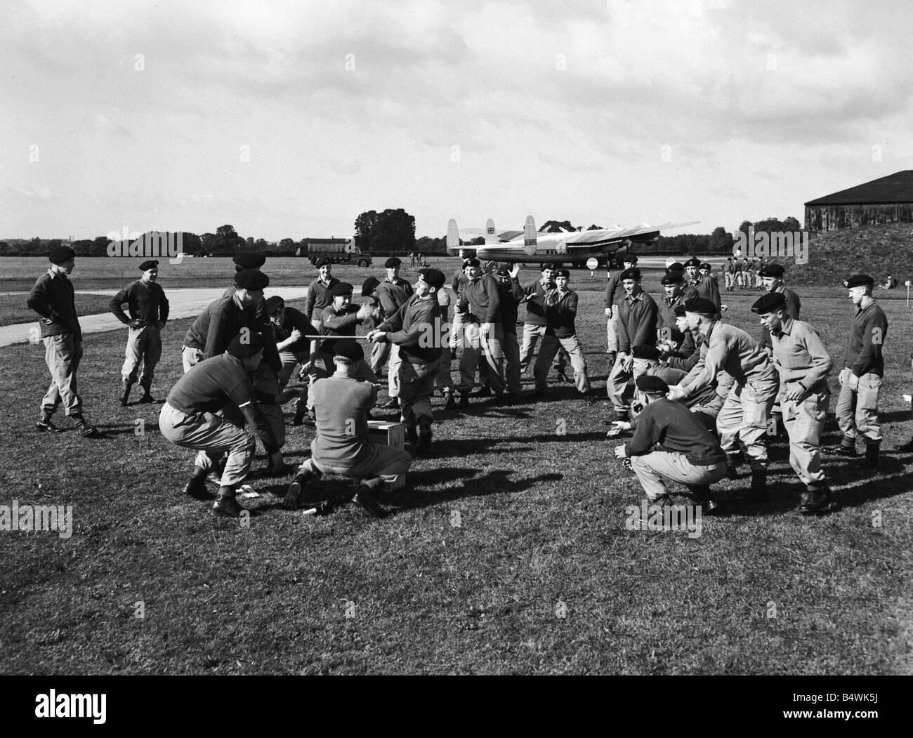 Suez Crisis 1956 Men of the Duke of Wellington Regiment at Blackbushe airport play cricket while repairs are carried - Stock Image