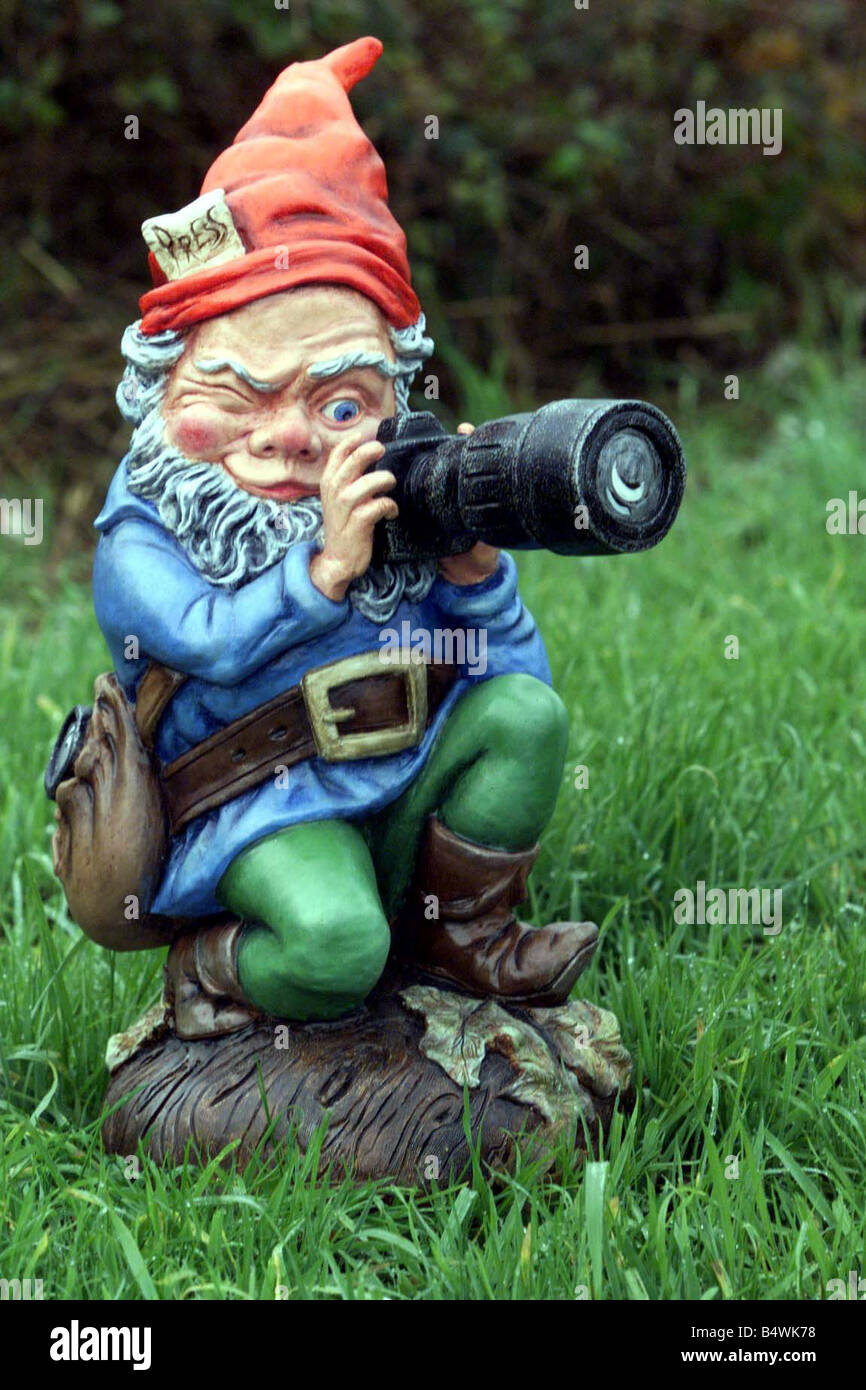 Garden Gnome Photographer with Camera November 1998 Prince Charles 50th Birthday Present from the Mirror Sun Telegraph Stock Photo
