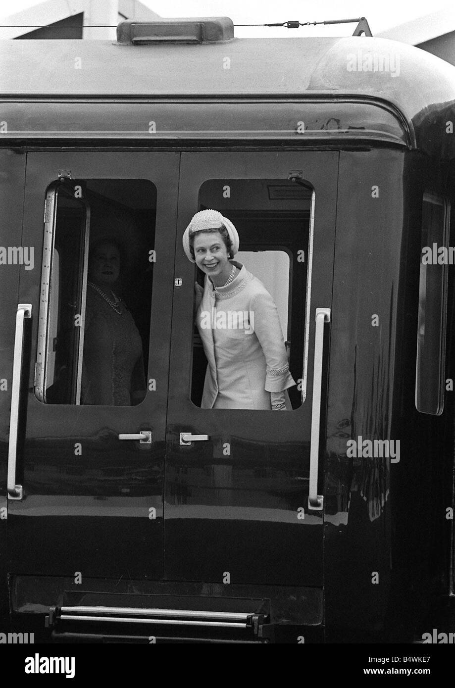 Prince Charles Investiture as Prince of Wales 1969 Queen Elizabeth smiles as she arrives by train at Caernarvon - Stock Image
