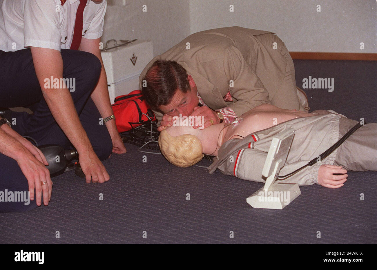 Prince Charles getting up close and personal with a resussitation dummy at the Red Cross HQ in New Zealand Royalty - Stock Image