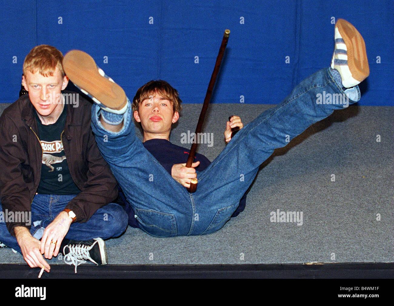 damon albarn lead singer of the pop group blur lying on the floor