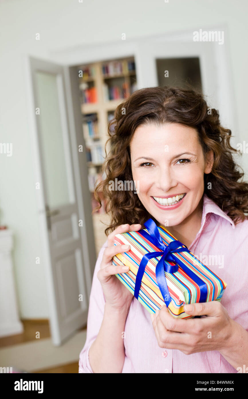 Woman happy about her birthday present - Stock Image